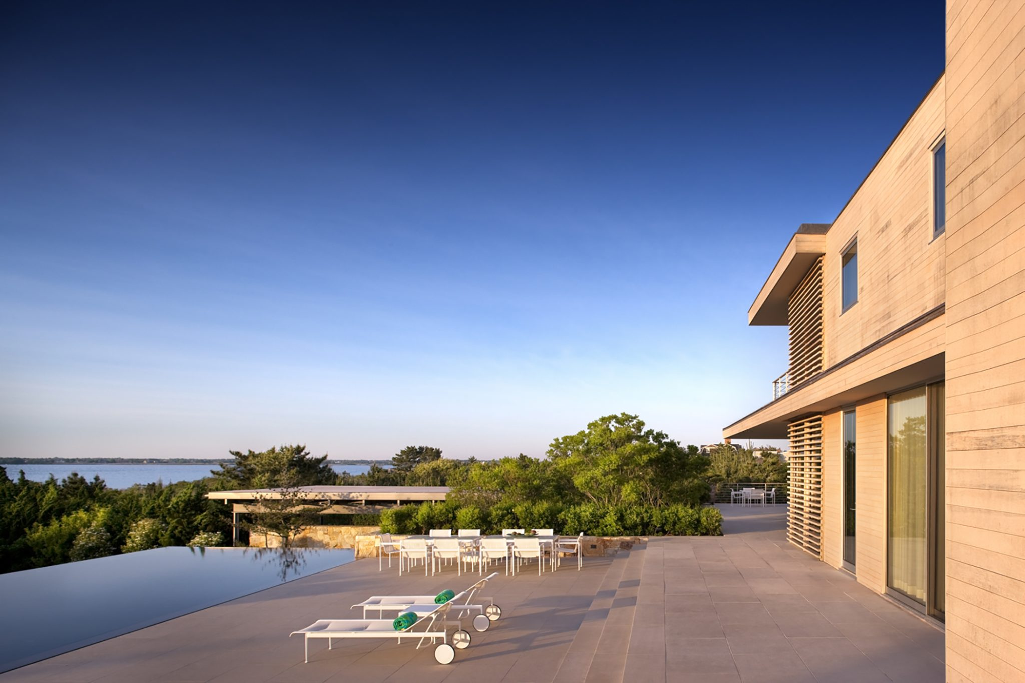 Poolside looking over the bay by LaGuardia Design Group