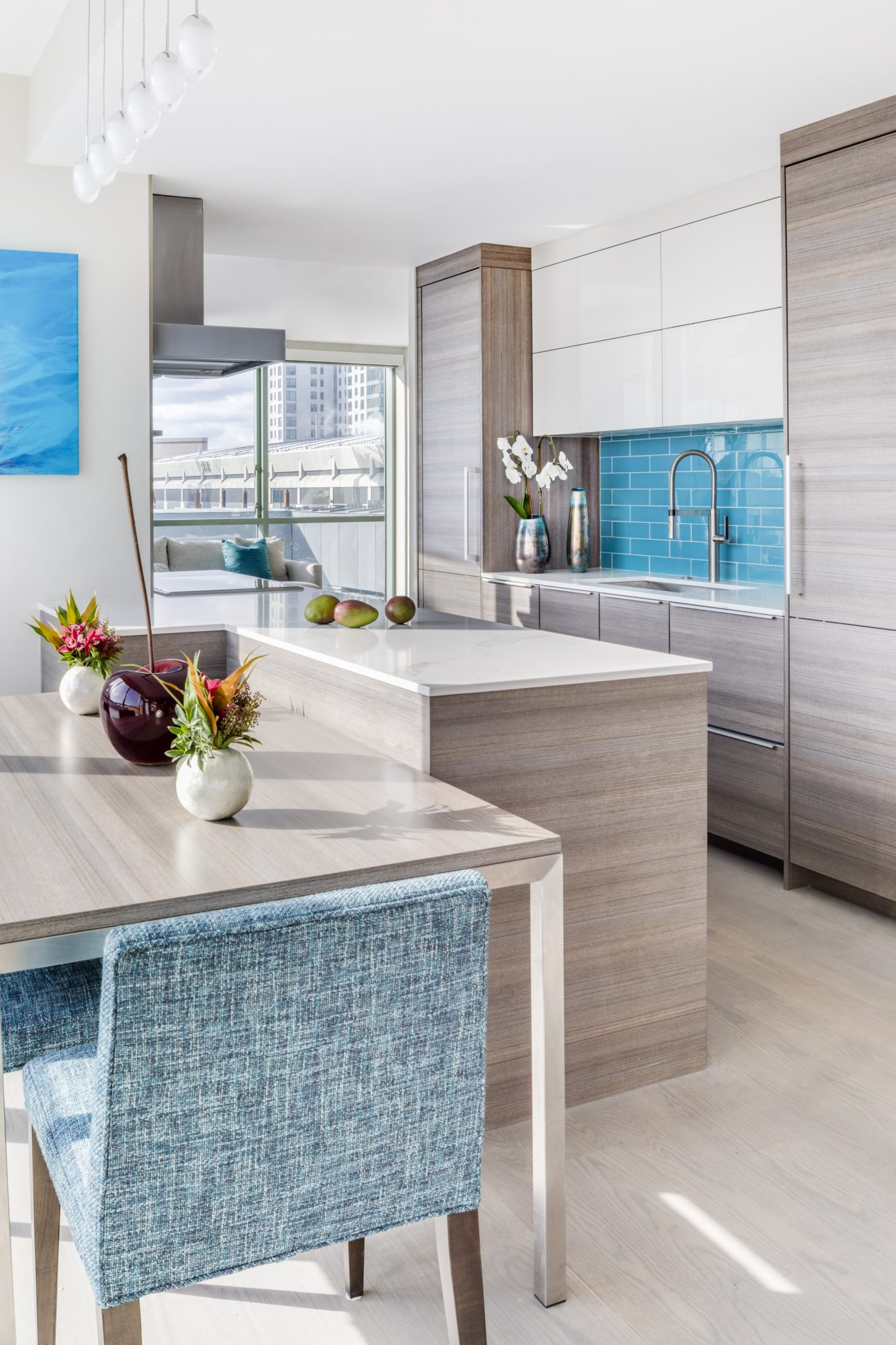 Boston contemporary kitchen, integrated dining table, lacquer, glass subway tile by JN Interior Spaces