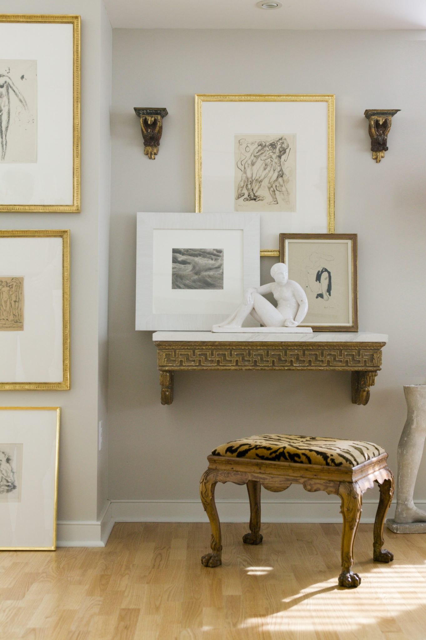 Layered art in aneutral vignette by Charles Spada Interiors