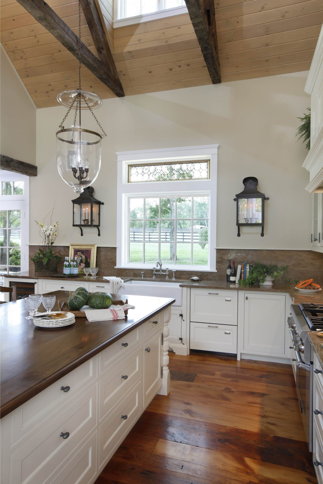 Trotter's Green kitchen with pine floor, beams, beadboard ceiling and bridge faucet by Deborah Leamann Interior Design