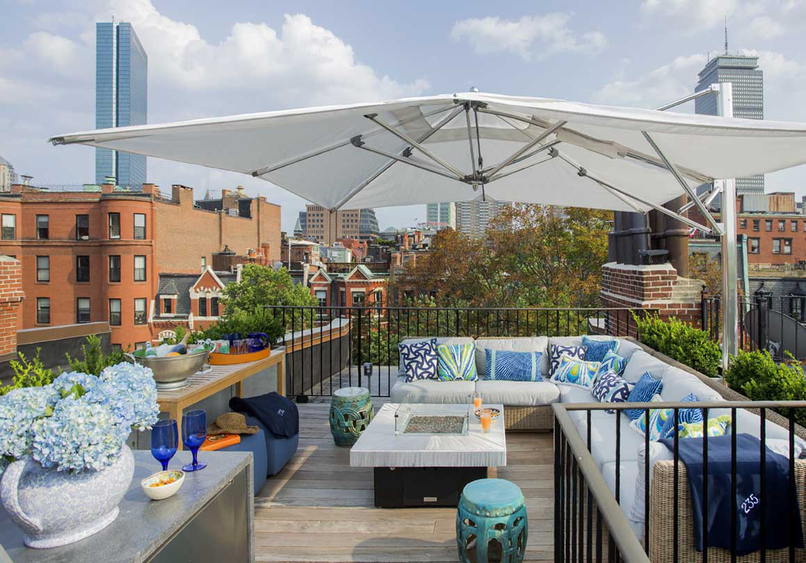 Roof deck with city views by Kristin Paton Interiors