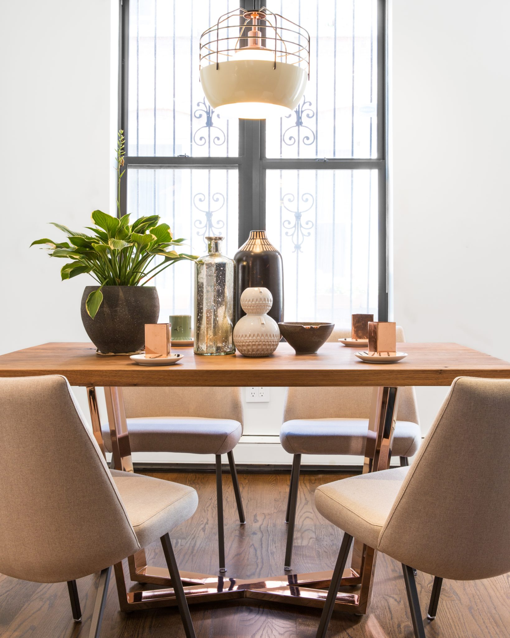 Custom dining room table and upholstered chairs by designs by human.