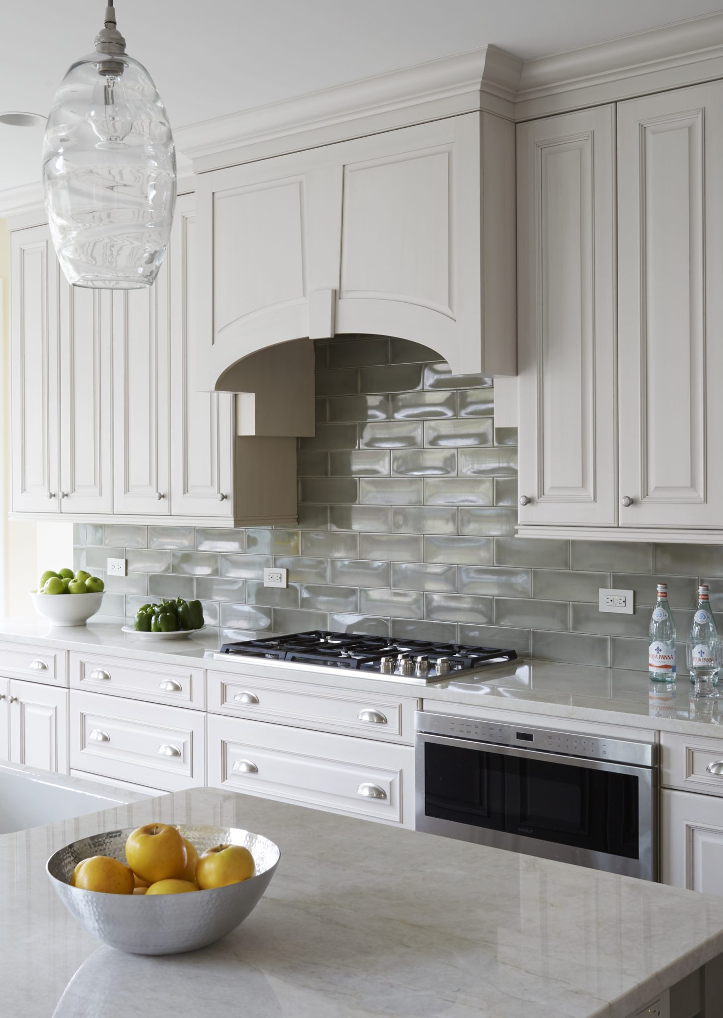 Range hood detail with clay tile backsplash by Orren Pickell Building Group
