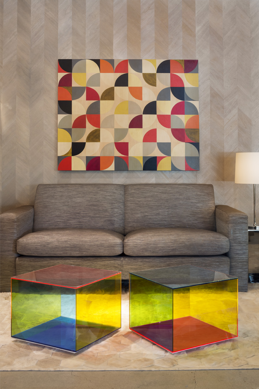 Colorful art and accent tables in a vignette by Thomas Lavin