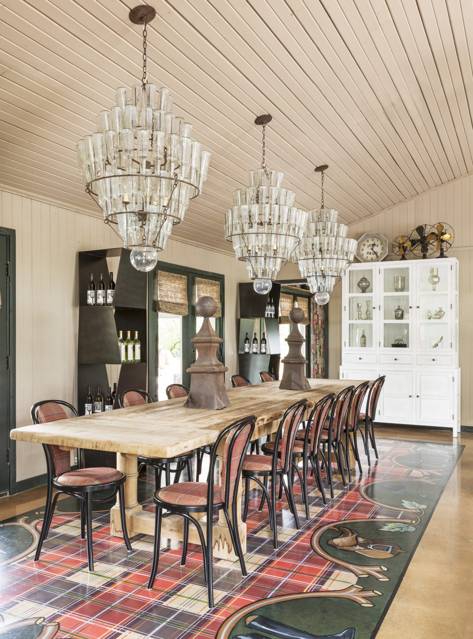 Dining room with hand-painted equestrian theme floor by Goddard Design Group