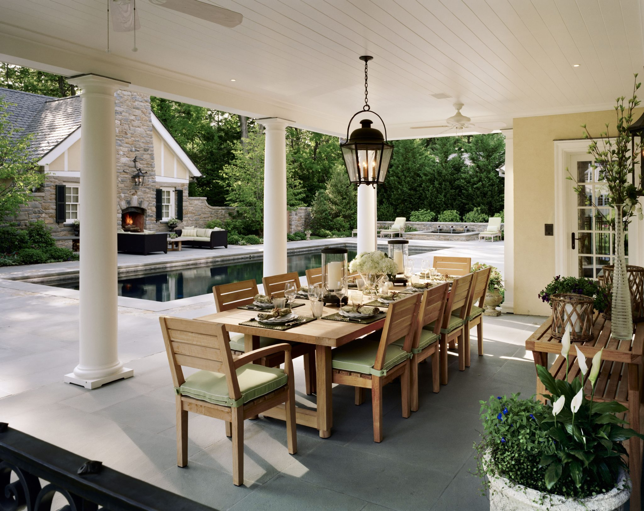 Westchester stucco colonial dining porch by Charles Hilton Architects