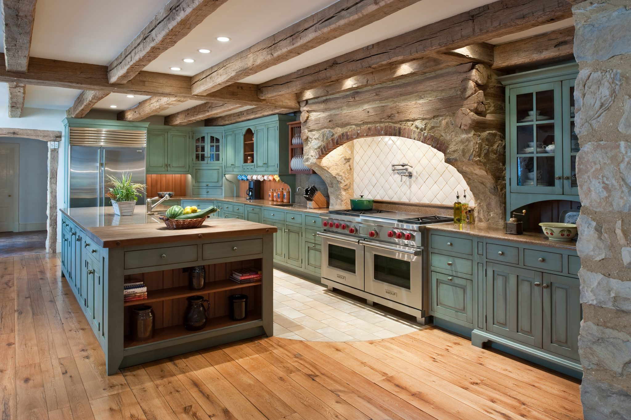 Rustic farmhouse kitchen with custom wood and stone range hood in Pennsylvania by Period Architecture