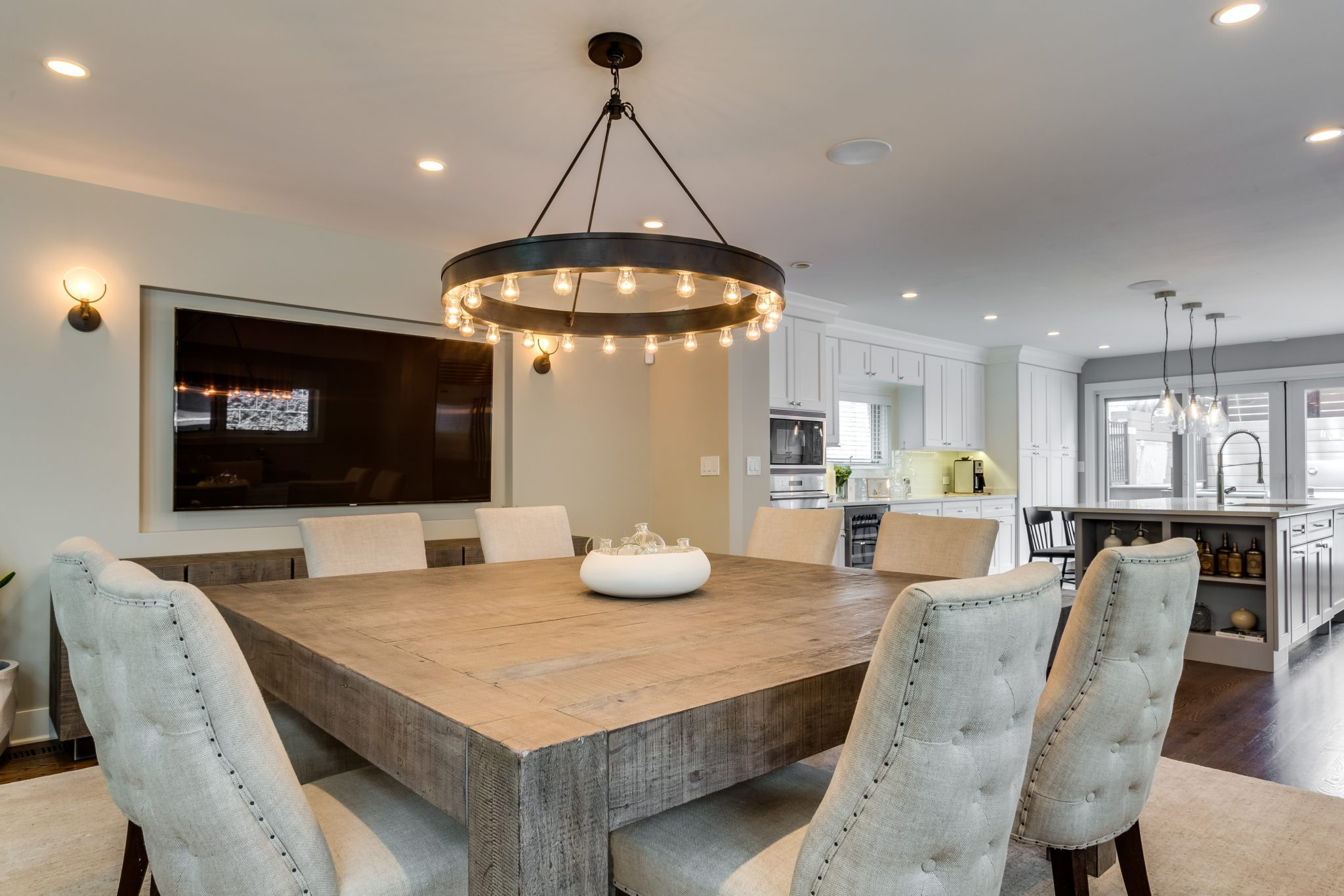 Transitional Eating Area, Dining Room with raw wood table and tufted chairs by Rae Duncan Interior Design