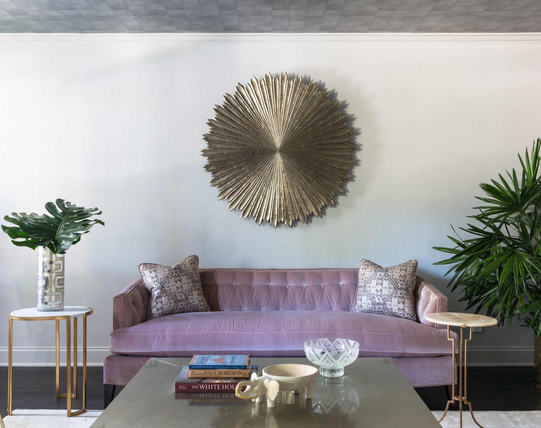 Formal living room detail of custom metal medallion on accent wall by Eclectic Home