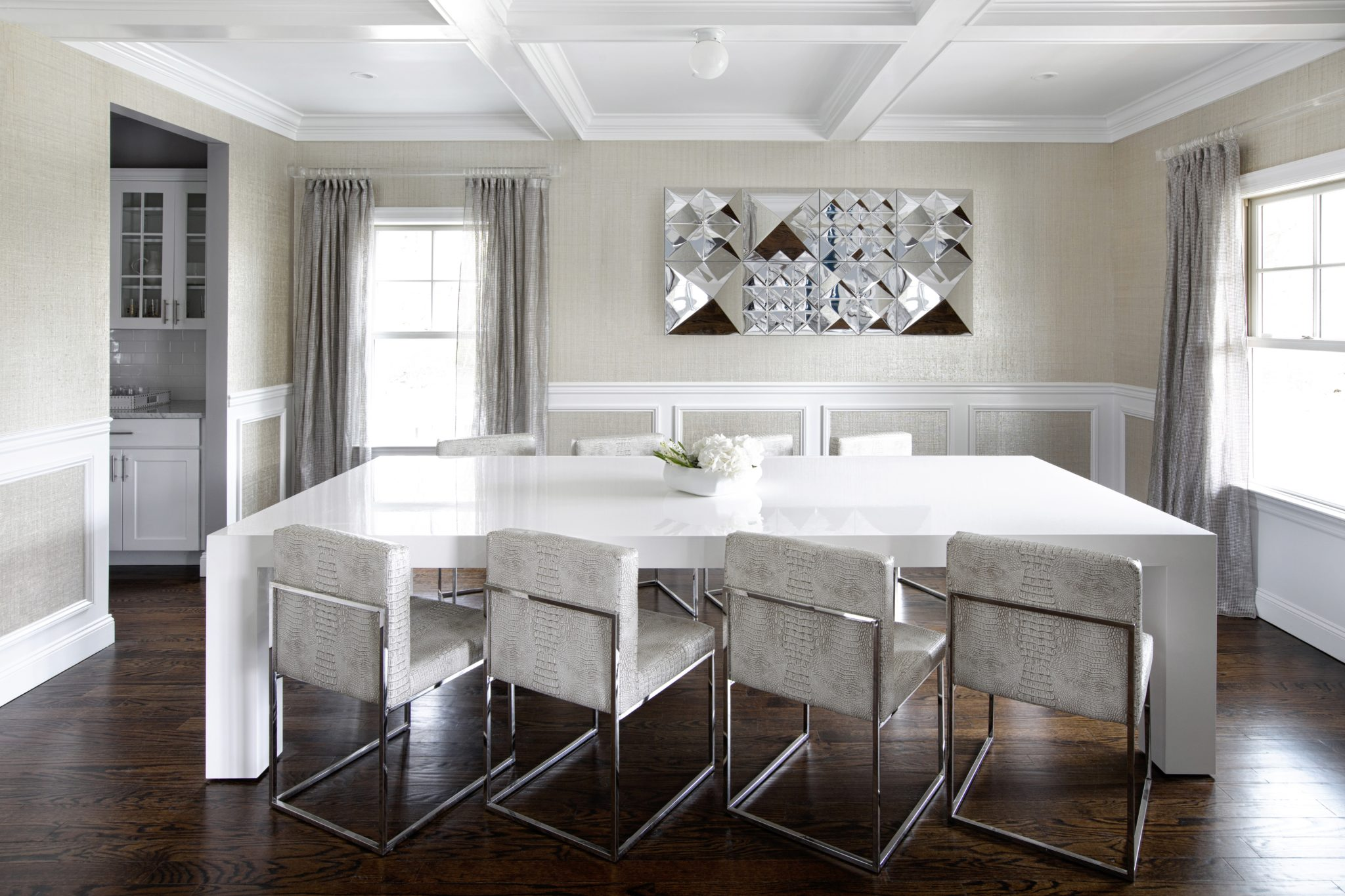 Dining room featuring crocodile vinyl chairs. by Laura Michaels Design