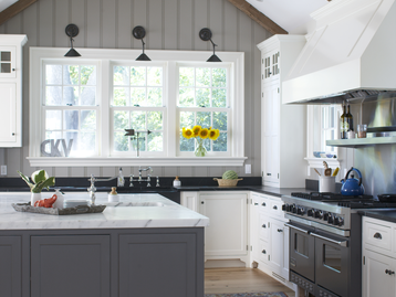 Farmhouse Kitchen with with Black Soapstone Counter & Reclaimed Beamed Ceiling by Patrick Ahearn Architect