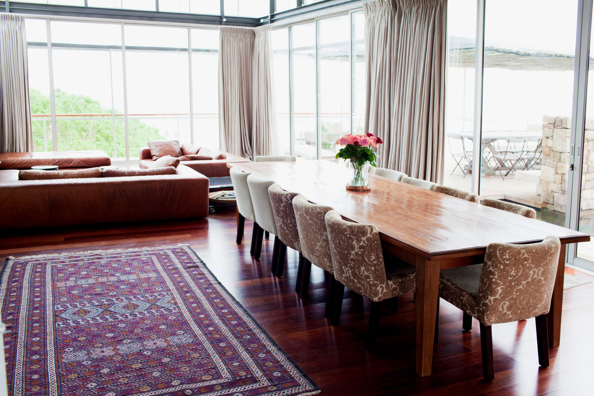 Lake Side Home with Large Dining Table and Mixed Chairs by Art Home Garden