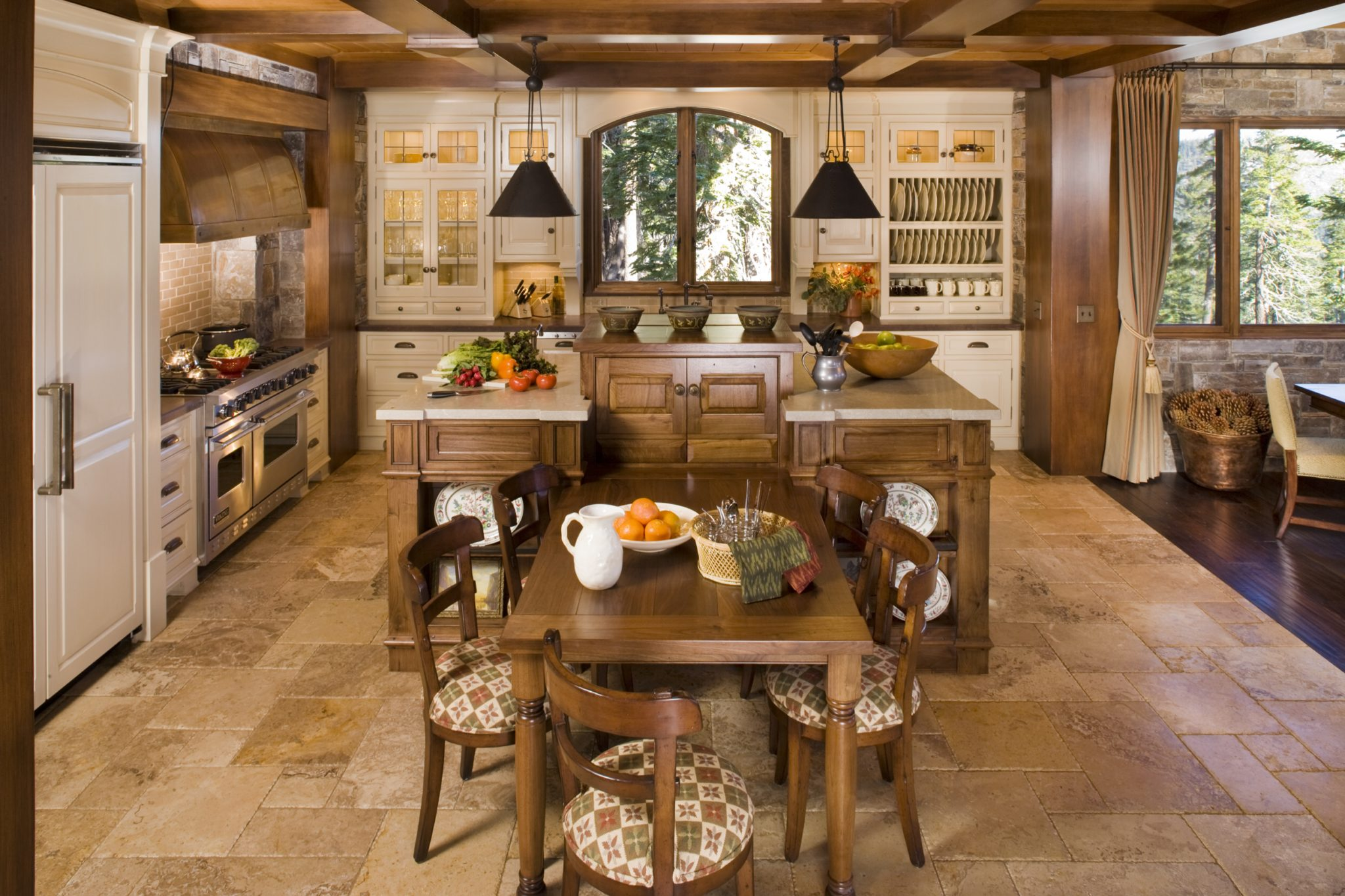 Traditional mountain home in Mammoth featuring walnut cabinetry by Brown Design Group