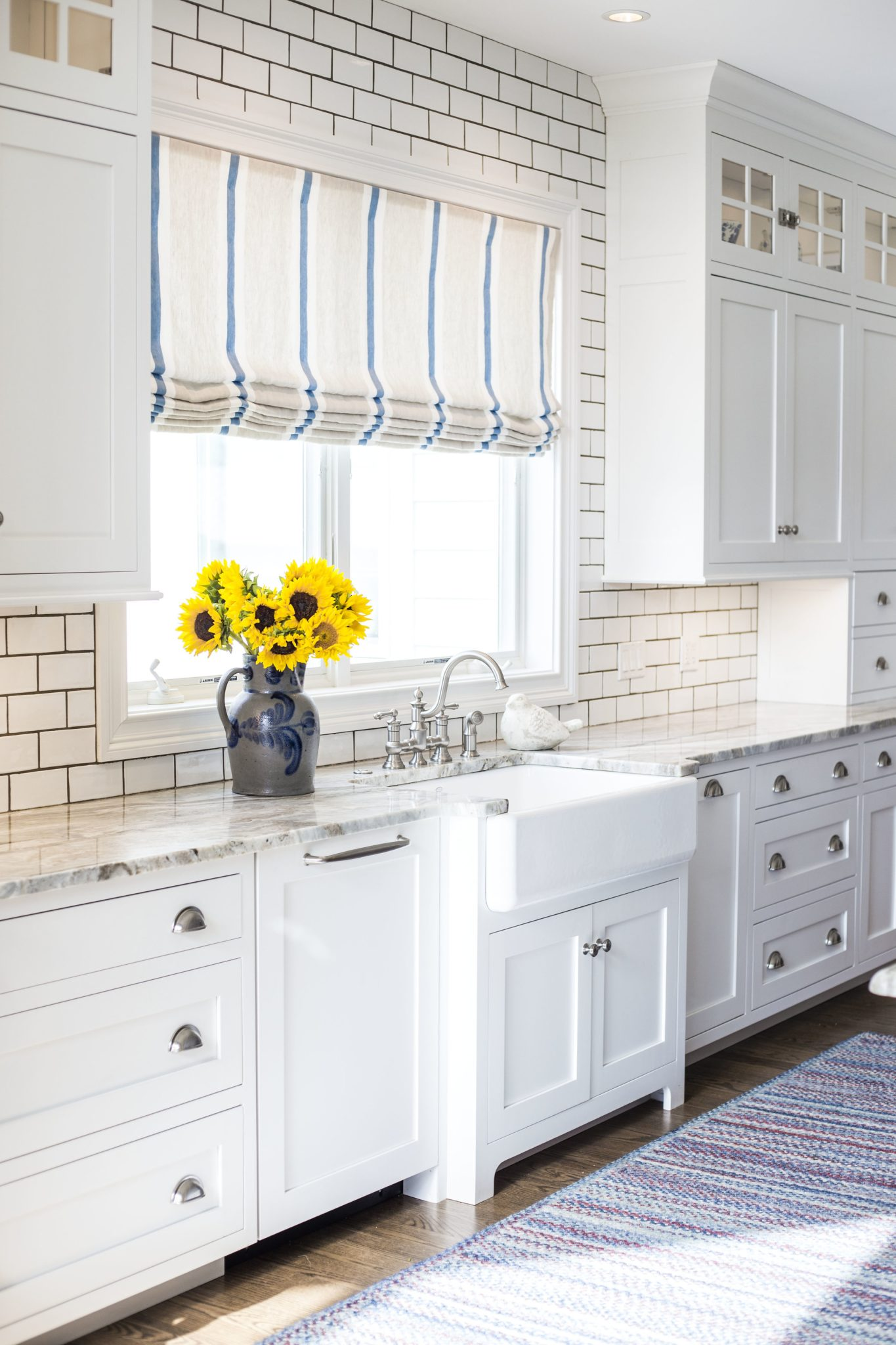 Blue and white farmhouse kitchen, farmhouse sink close up by LSM Interior Design