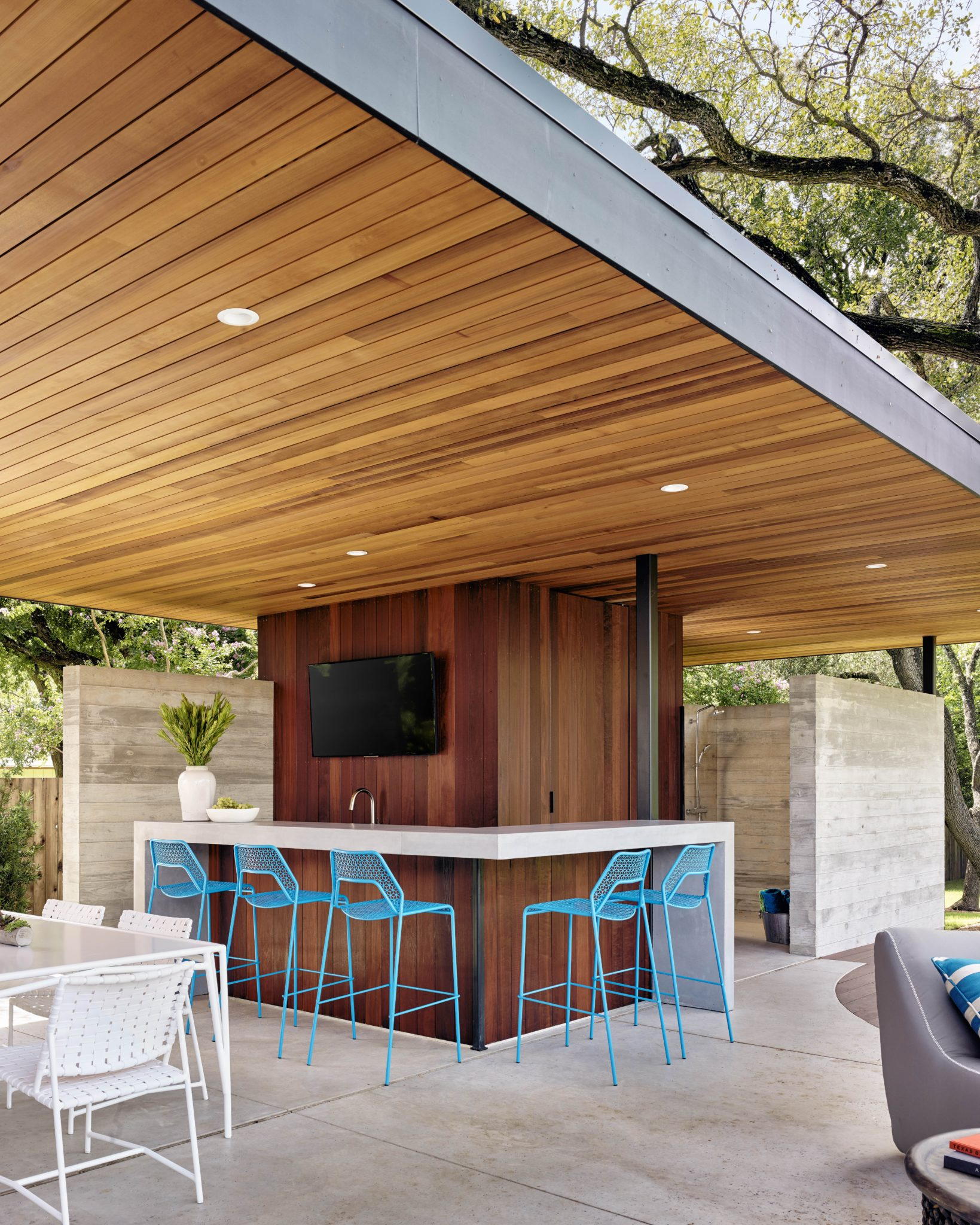 Modern outdoor bar and patio inAustin, Texas,by Greer Interior Design