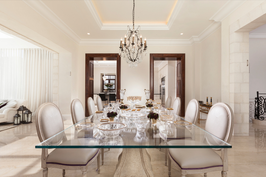 Majestic rectangular glass dining room table in landmark renovation. by Annette Frommer Interior Design