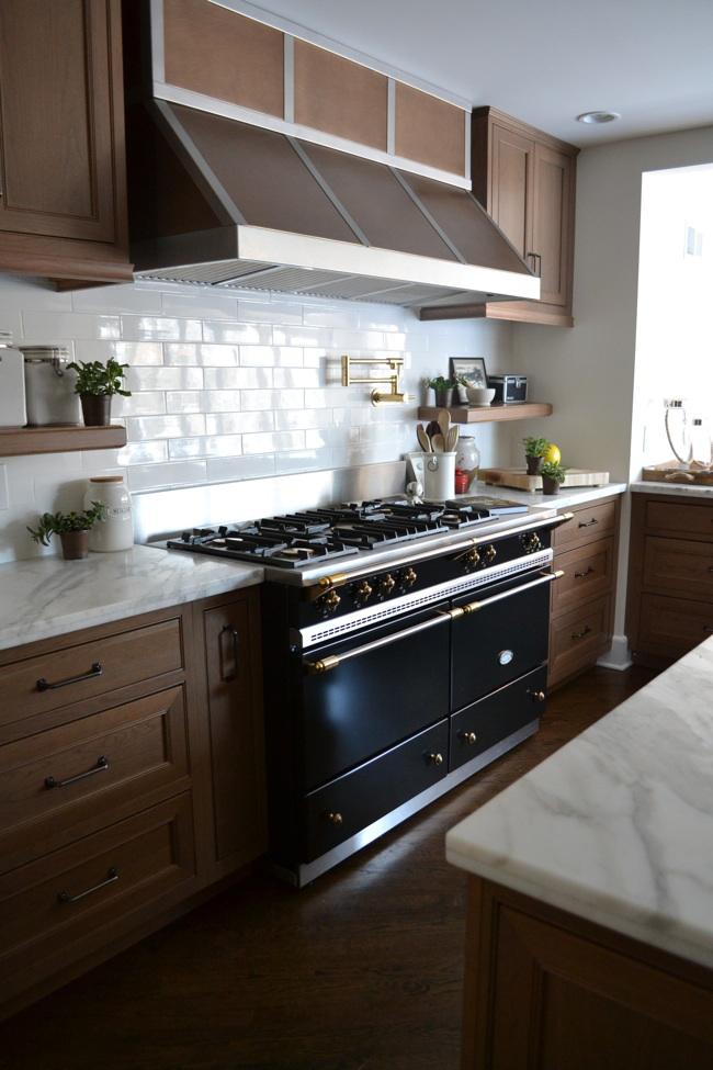 Kitchen with Lacanche range, handout subway tiles, custom range hood. by Uma Stewart Interiors & Lifestyle