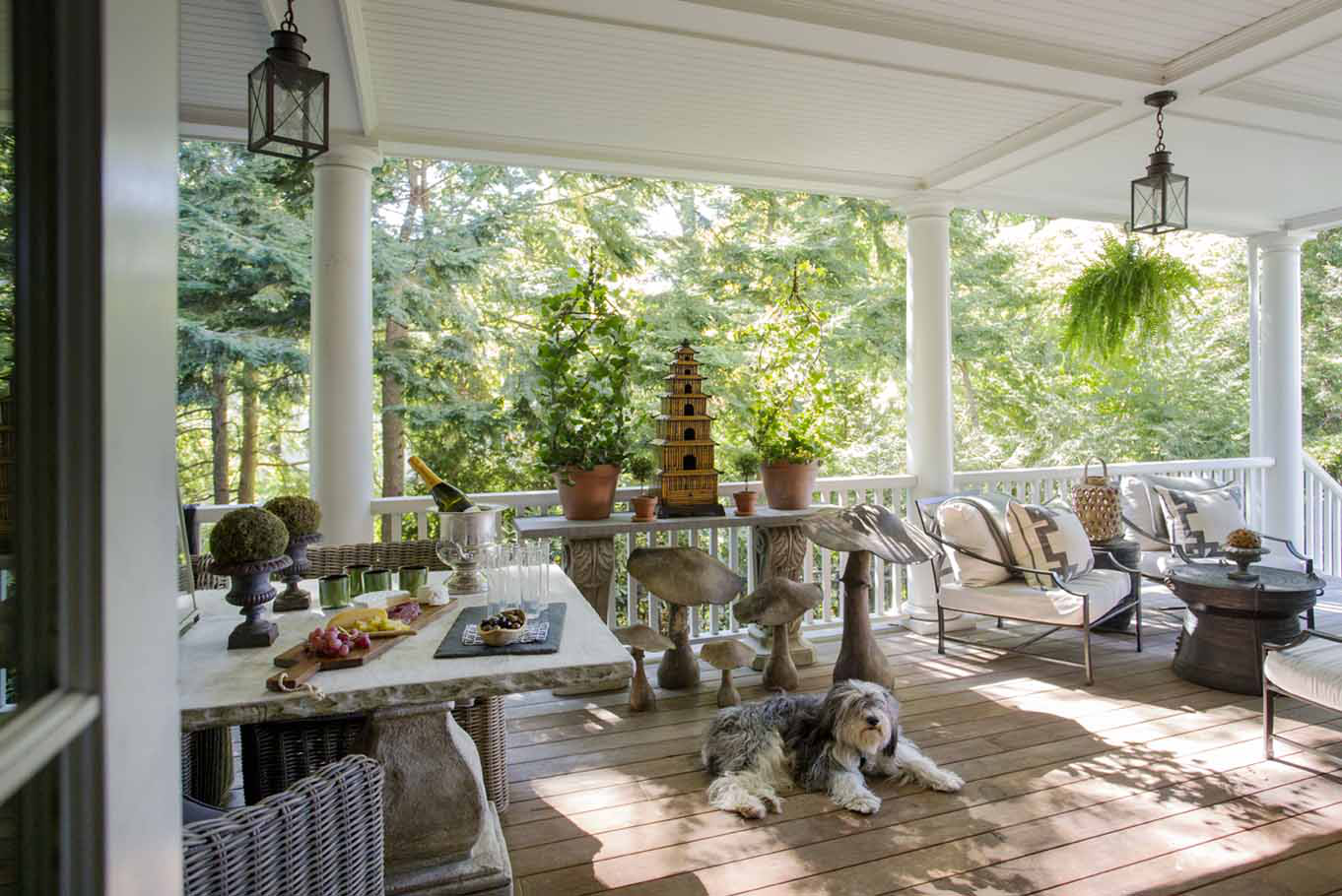 Covered porch for outdoor dining by Kristin Paton Interiors