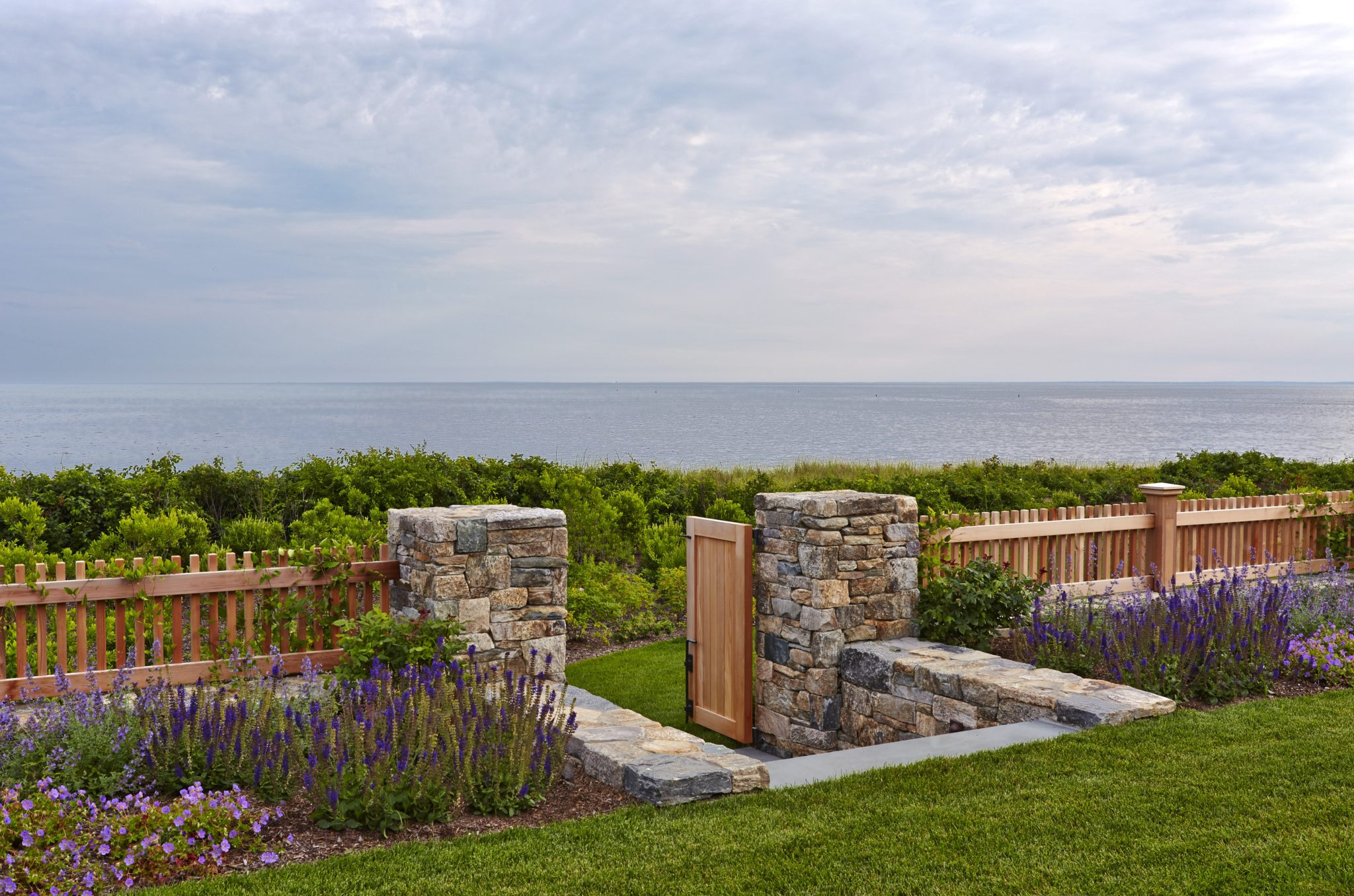 Custom gate and stairs leads from the pool terrace to the beach path by Dan Gordon Landscape Architects