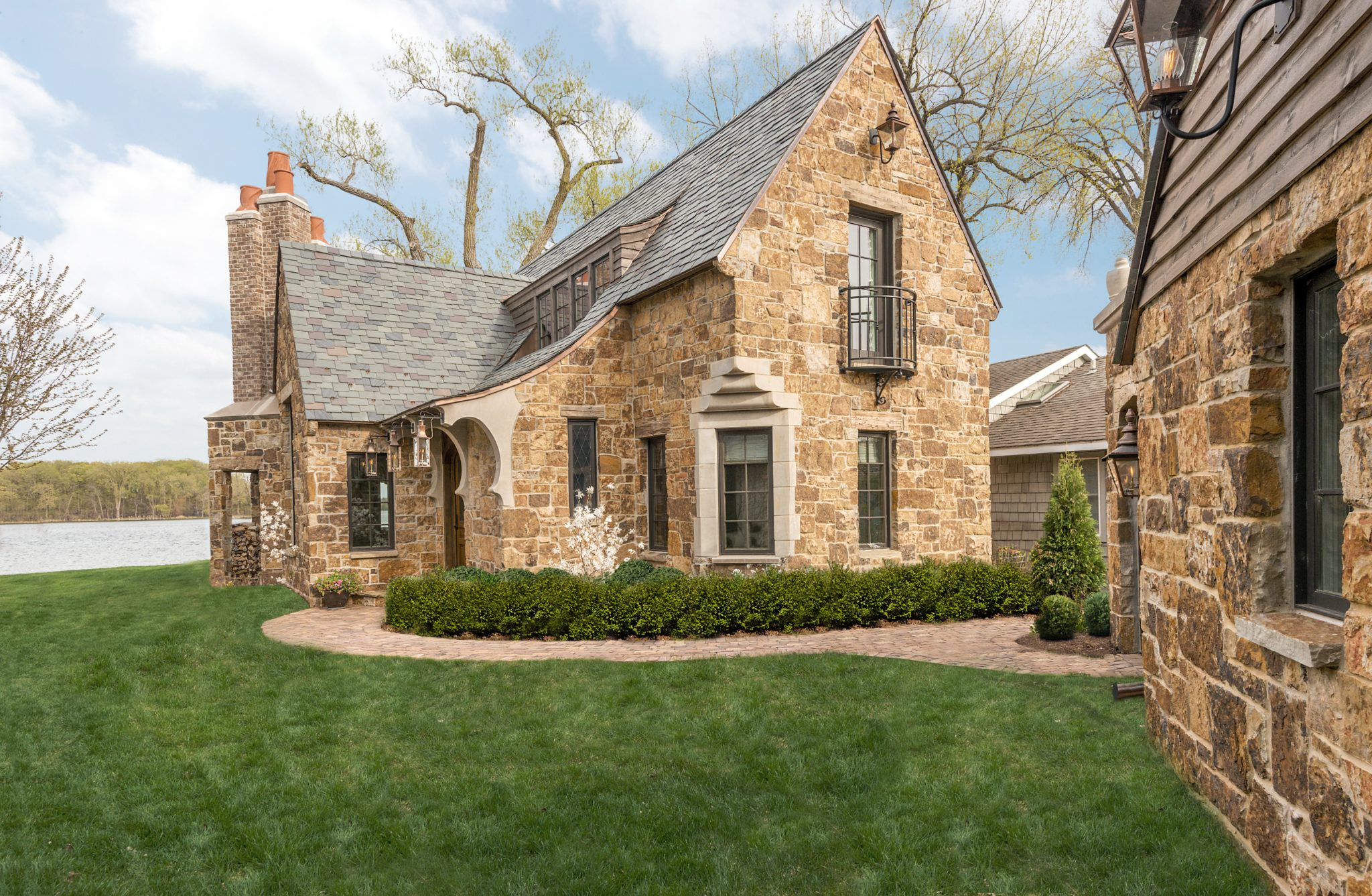 Stone guest cottage with staggered slate roof-Lake Minnetonka by Murphy & Co. Design