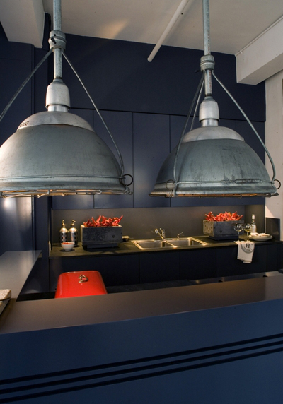 FLATIRON DISTRICT Oversized Industrial Pendants over Kitchen Island by P&T Interiors