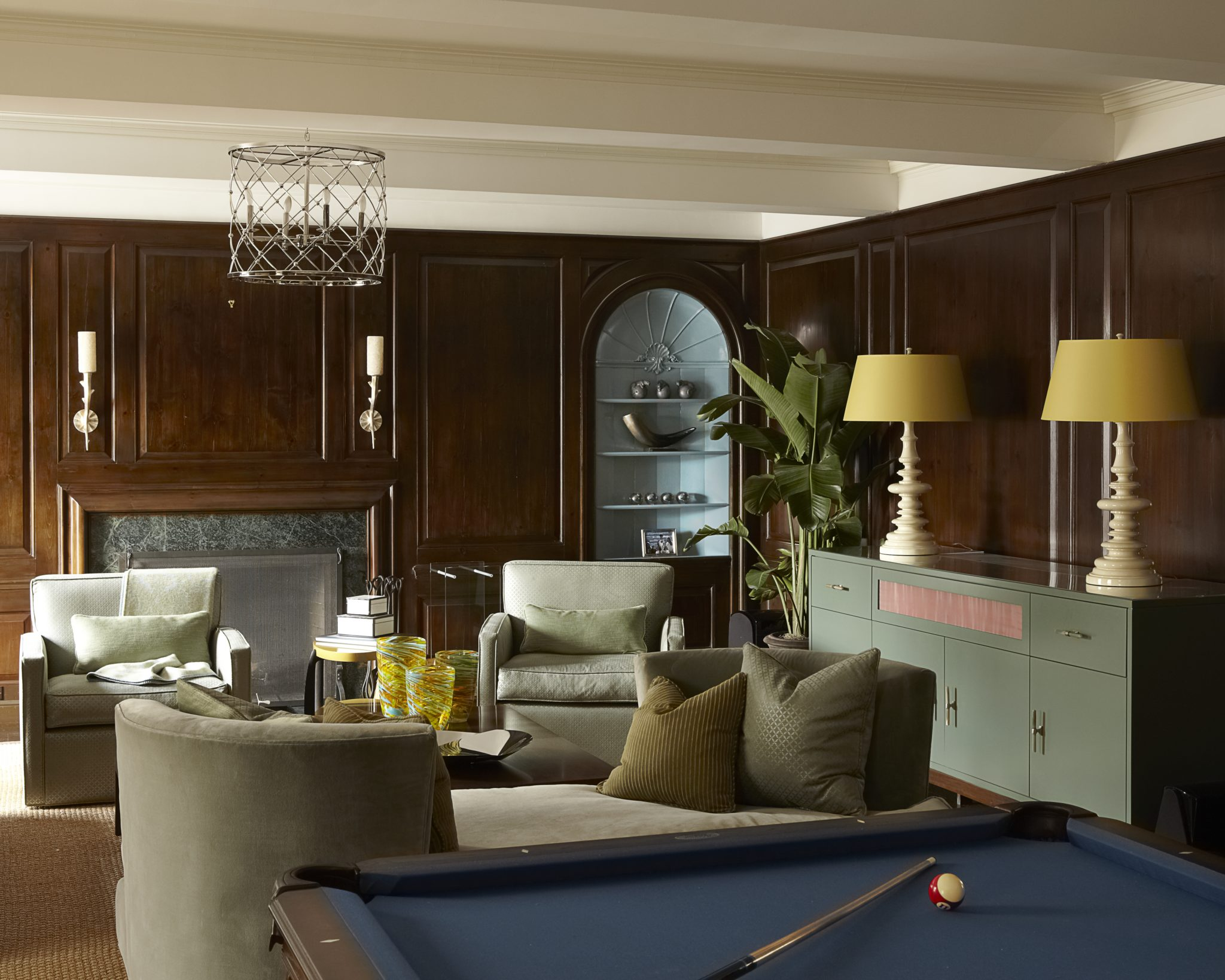 Sitting room in New York City with a billiards table by Carolyn Rebuffel Designs