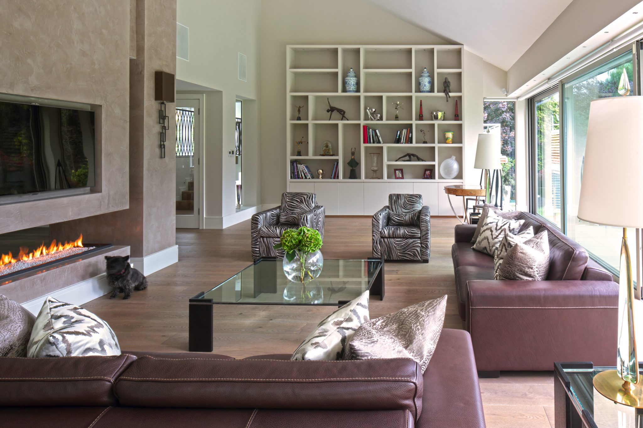 Open plan living room with bespoke joinery designed by dk INTERIORS