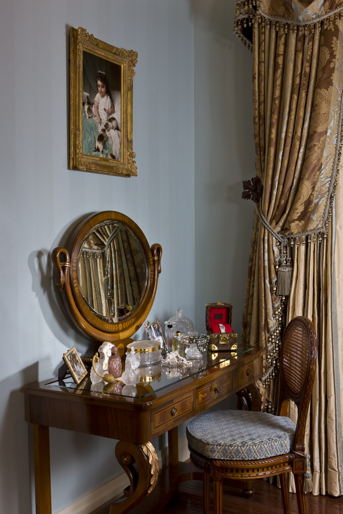 Lalique pieces enliven theColombo Mobili vanity in plum walnut. by Haleh Design