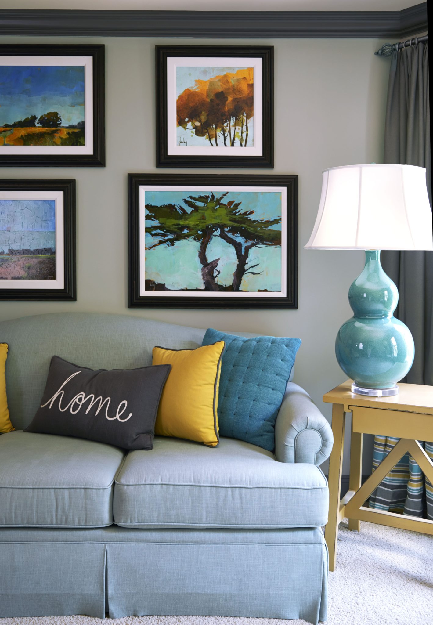 Blue and yellow sitting area by Meriwether Design Group