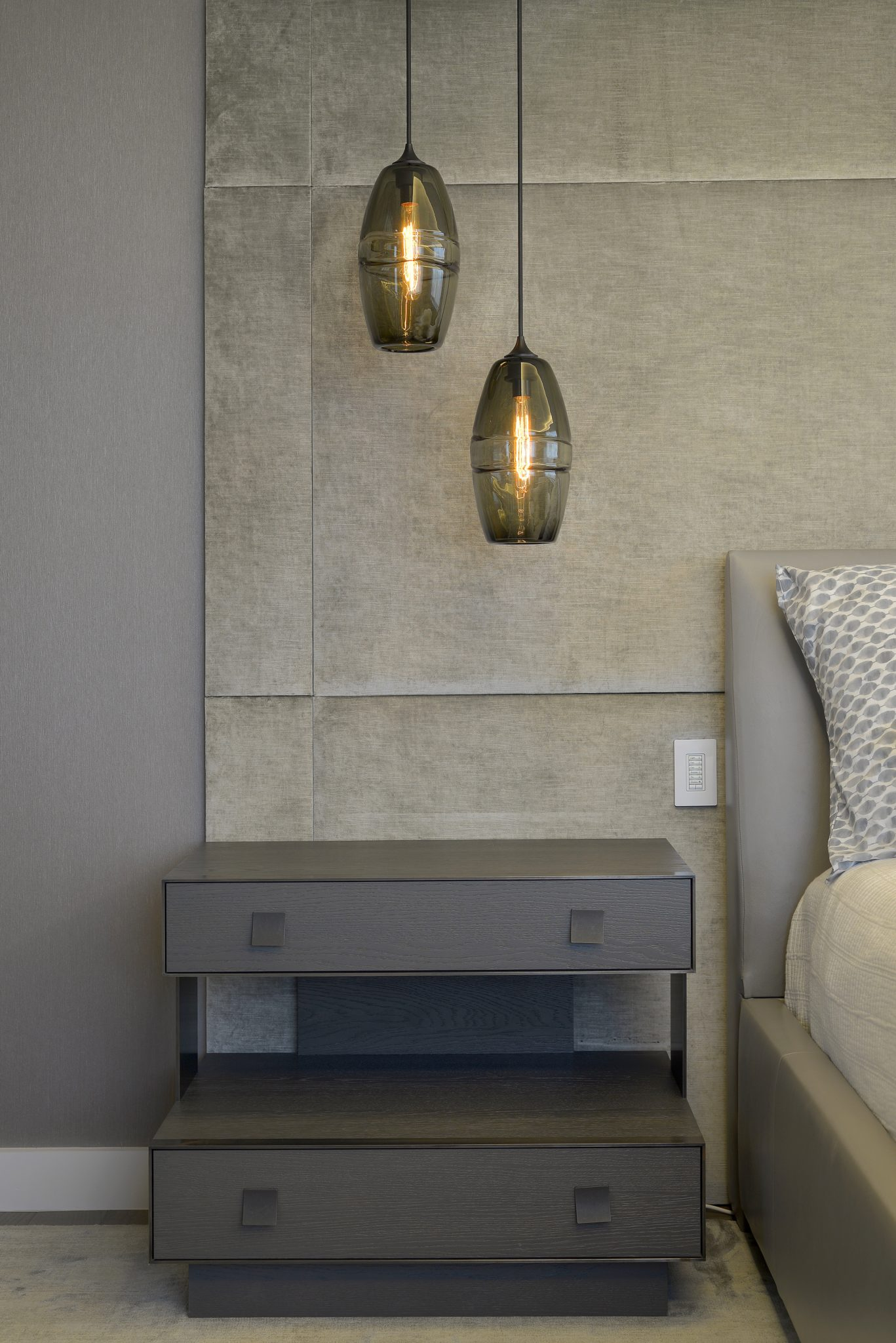A Pair of Pendant Lights Hang Above a Carol Kurth Designed Nightstand by Carol Kurth Architecture + Interiors