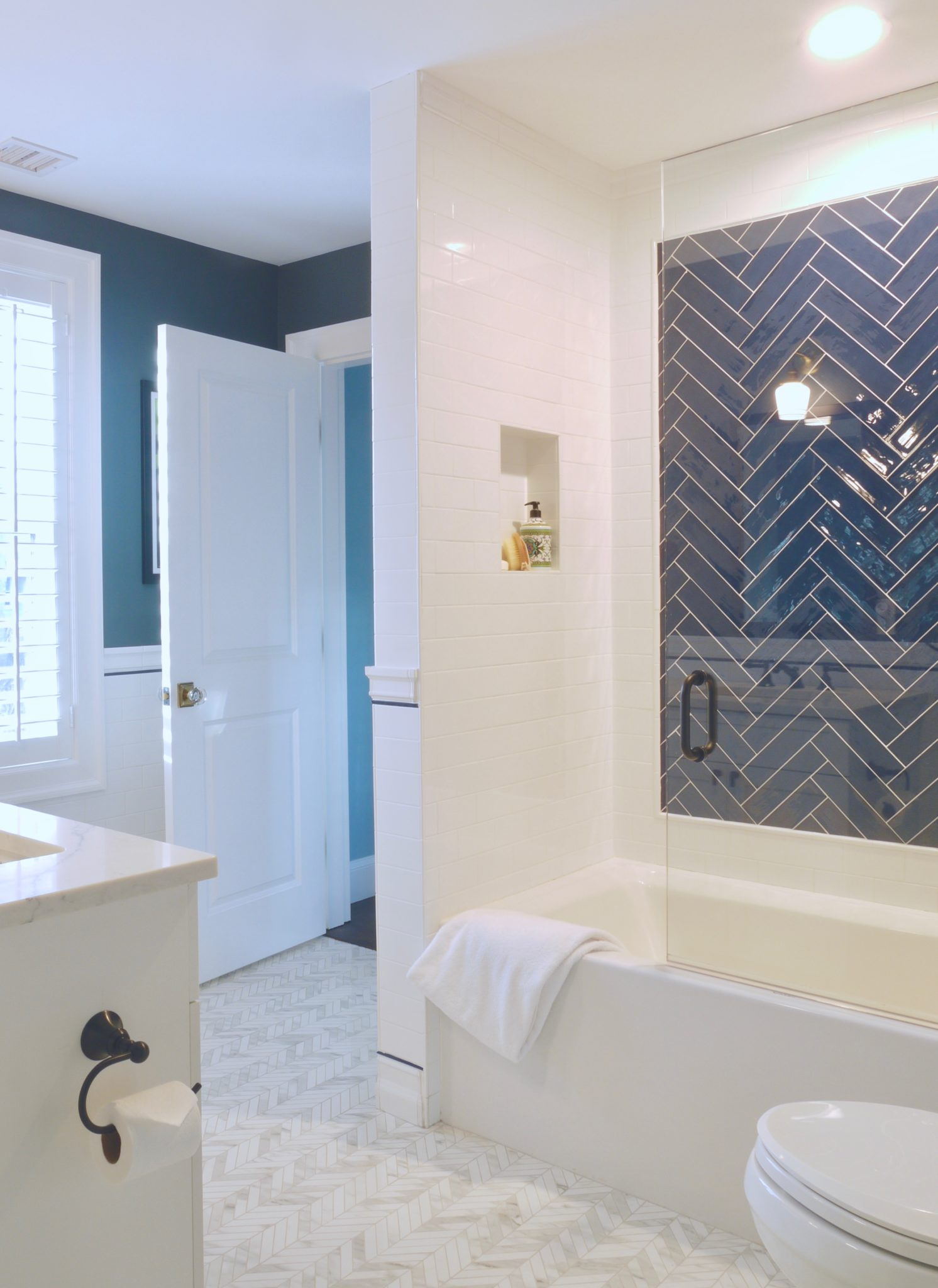 Blue and White Herringbone Boys Bath with Porcelain Chevron Floors by CW Design, LLC