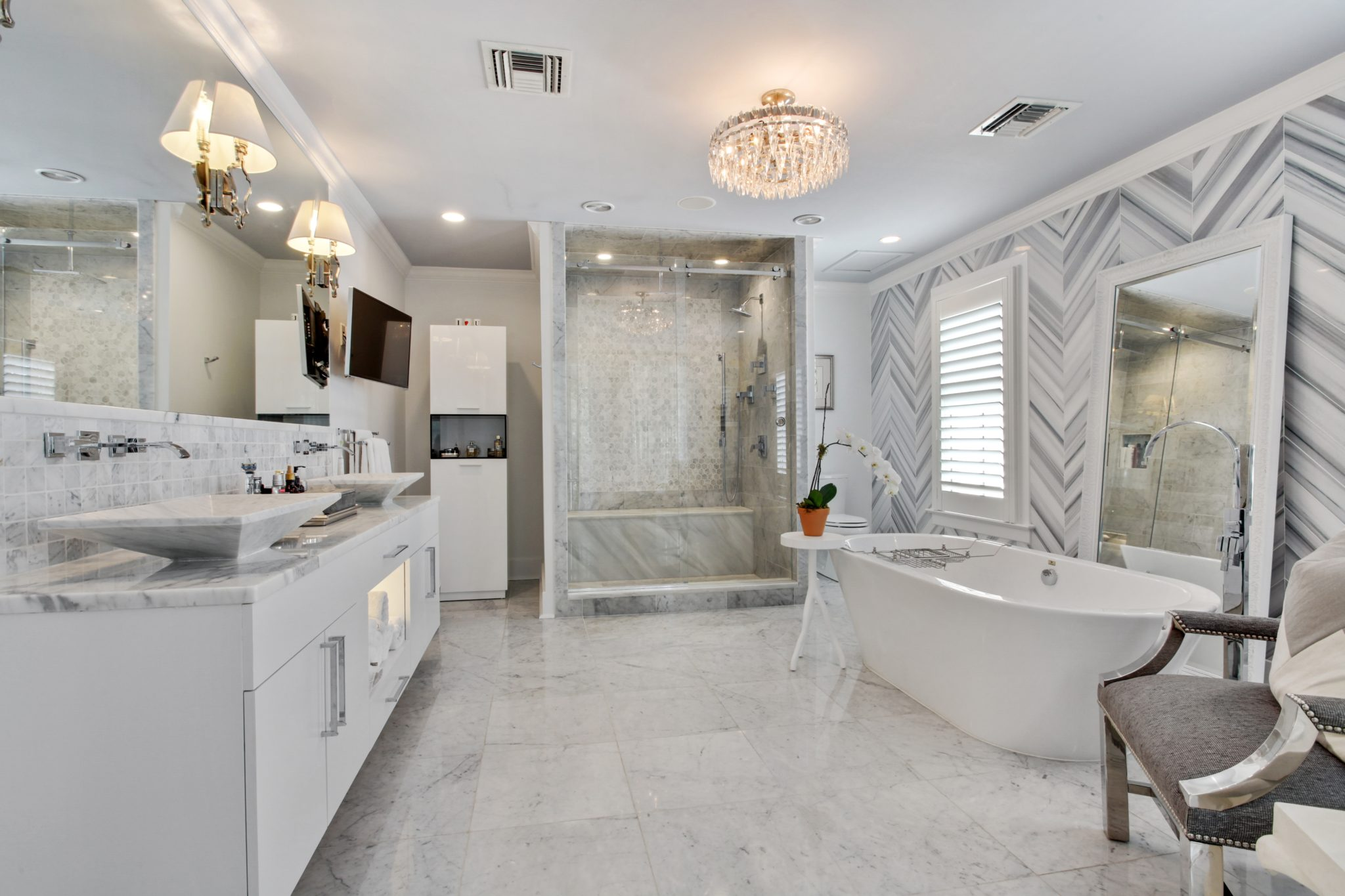 Modern Master Bathroom with chevron patterned marble wall by Eclectic Home