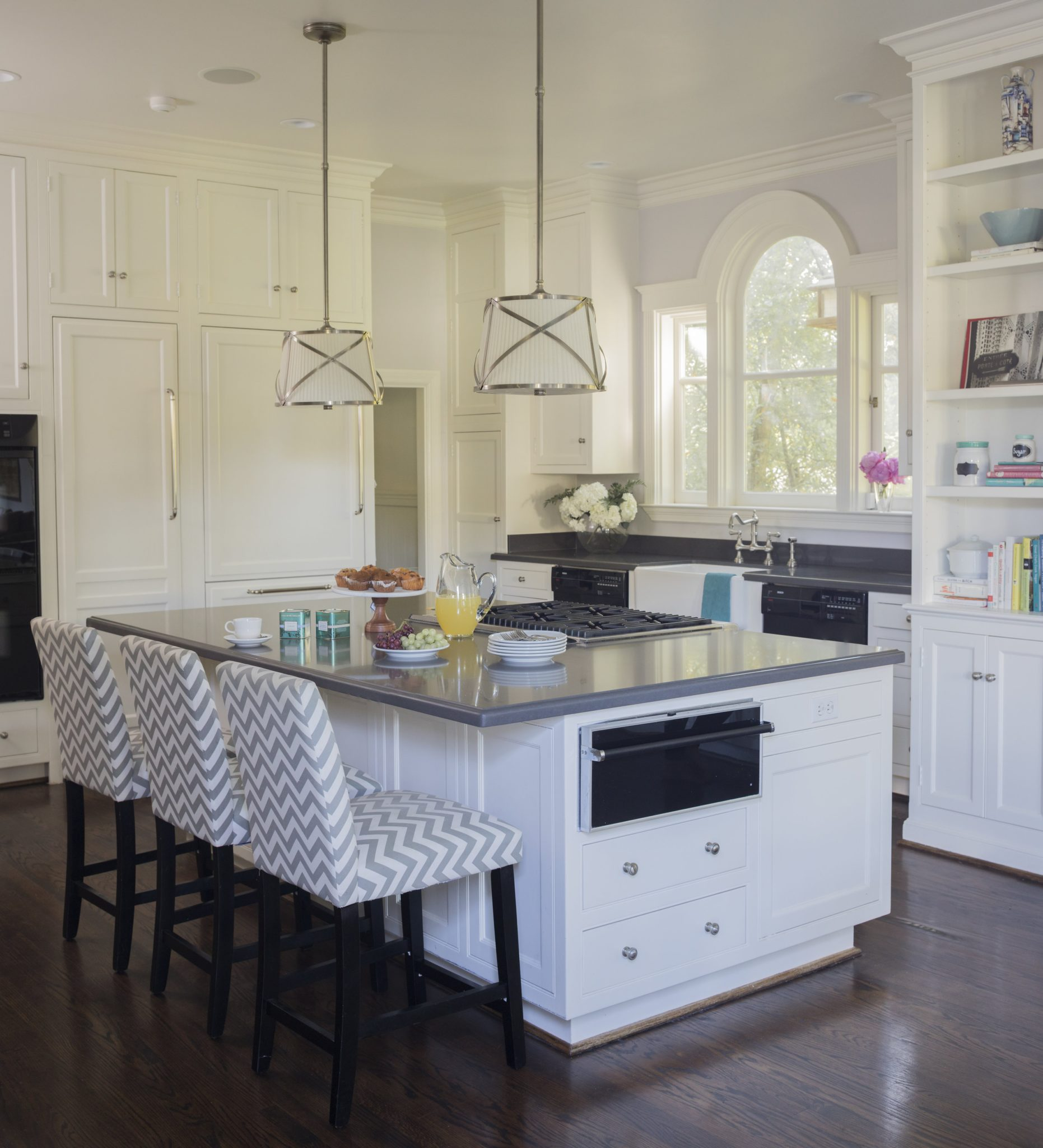 Eat In Kitchen with Chevron Stools and Center Island by McBrien Interiors