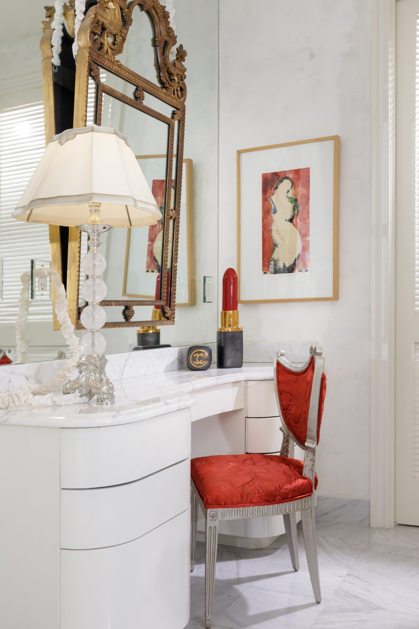 Dressing table in master bath with a striking touch of red by Goddard Design Group