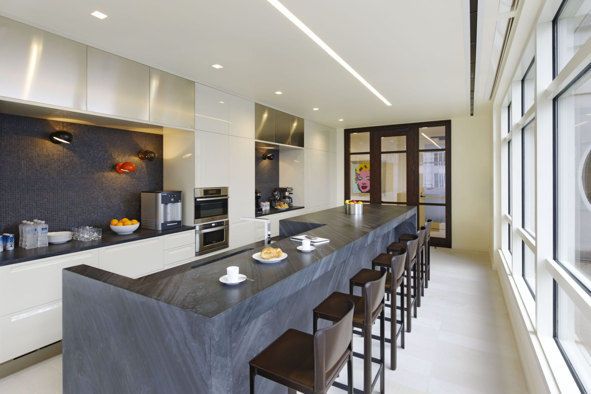 Kitchen space in investment management firm by Planeta Design Group