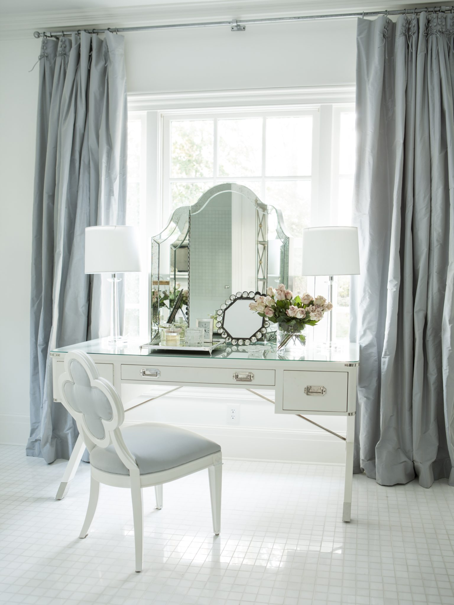At Home vanity in shades of blue and white by Suzanne Kasler Interiors