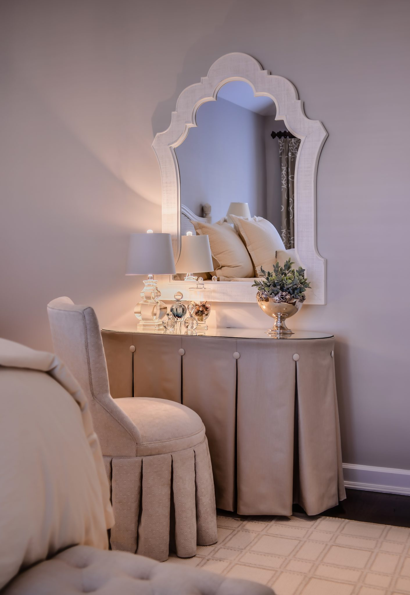 Vanity, mirrors, slipper chair, dressing room by Kim Radovich Interiors