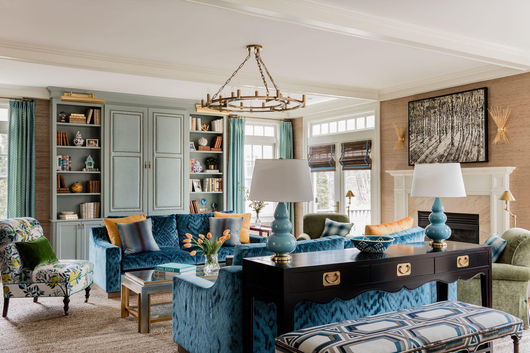 Living room with blue velvet matching sofas and robins egg built-in bookshelves by Robin Gannon Interiors