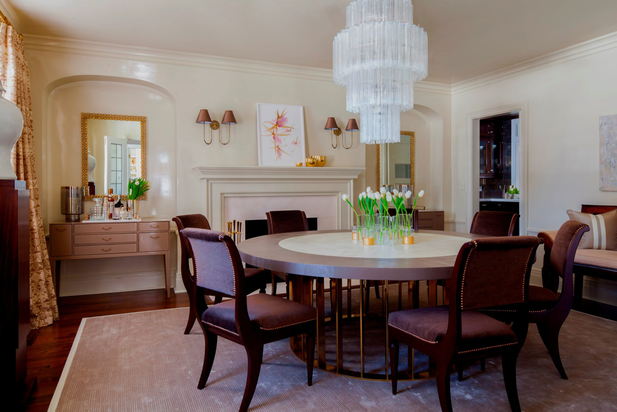 Dining room with high-gloss walls and ceiling with round table by S.B. Long Interiors