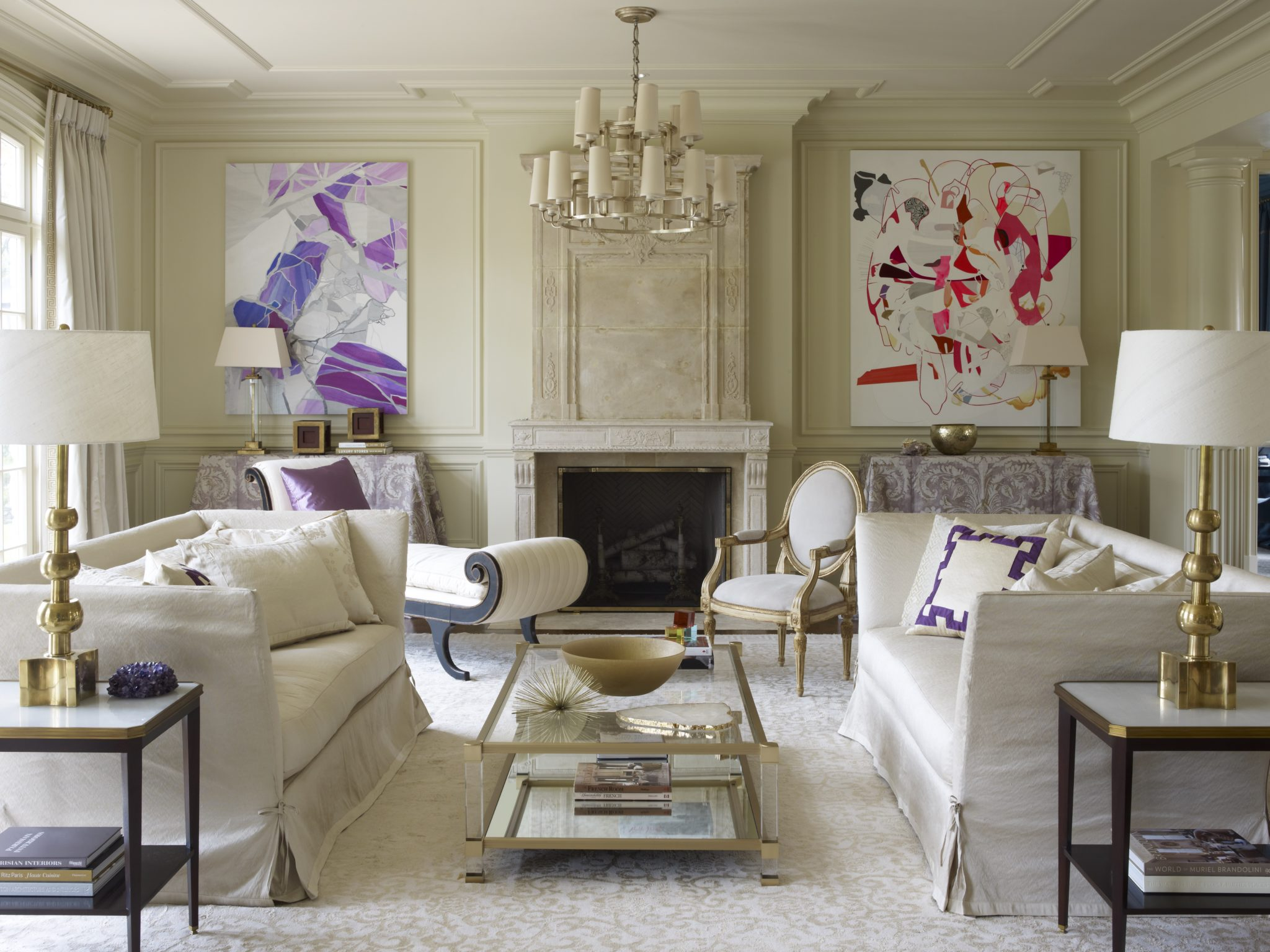 Chic neutral living room with bright art by Suzanne Kasler Interiors