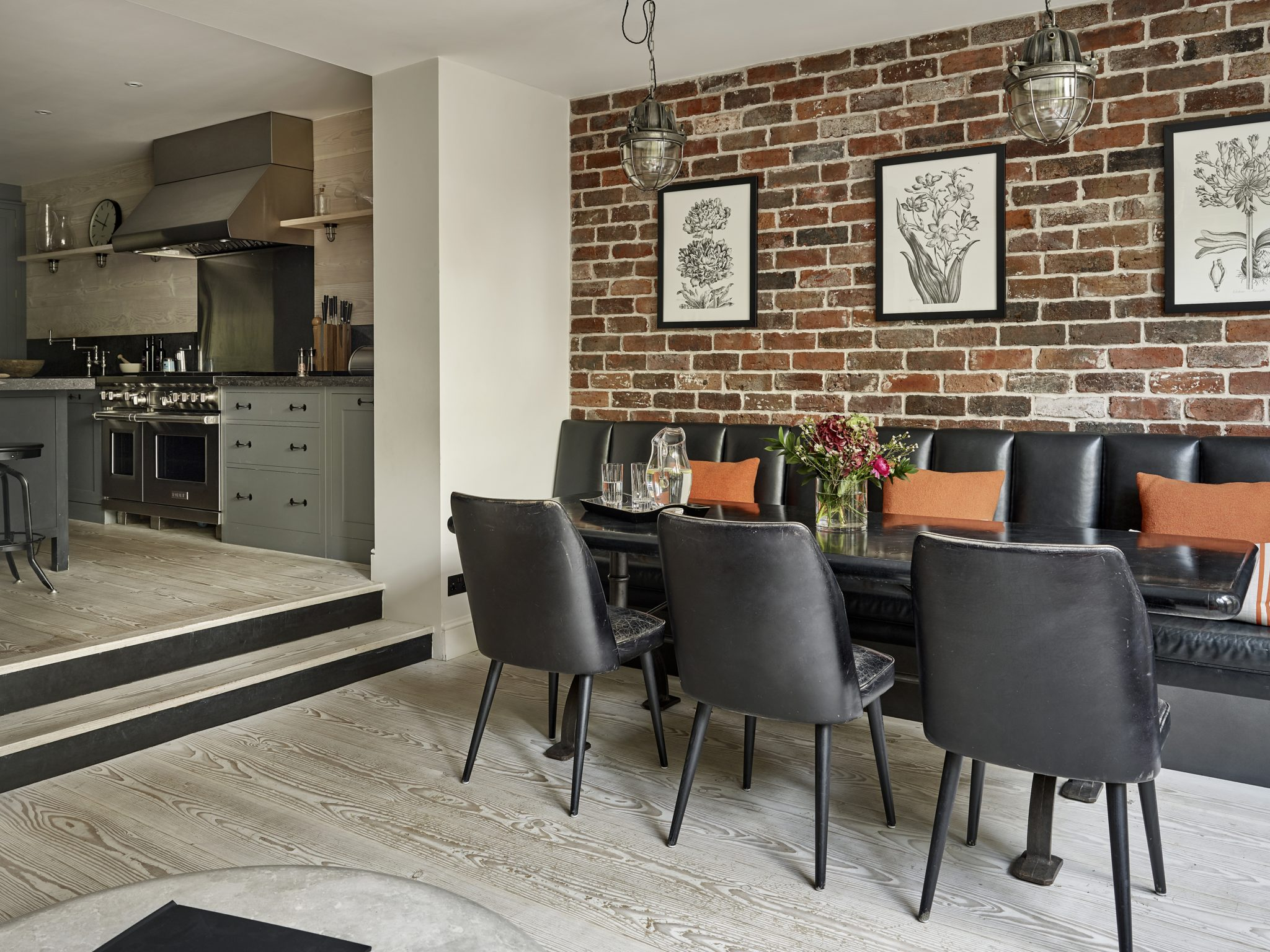 Dining area through to kitchen. Kensington, London by Caz Myers