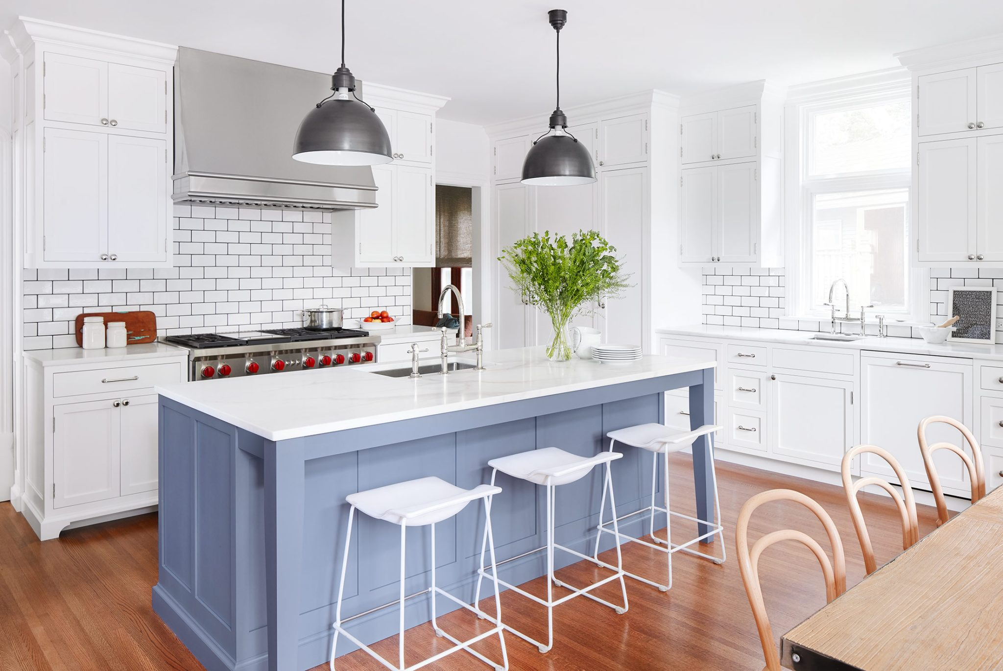 White kitchen with blue island by 2to5 Design