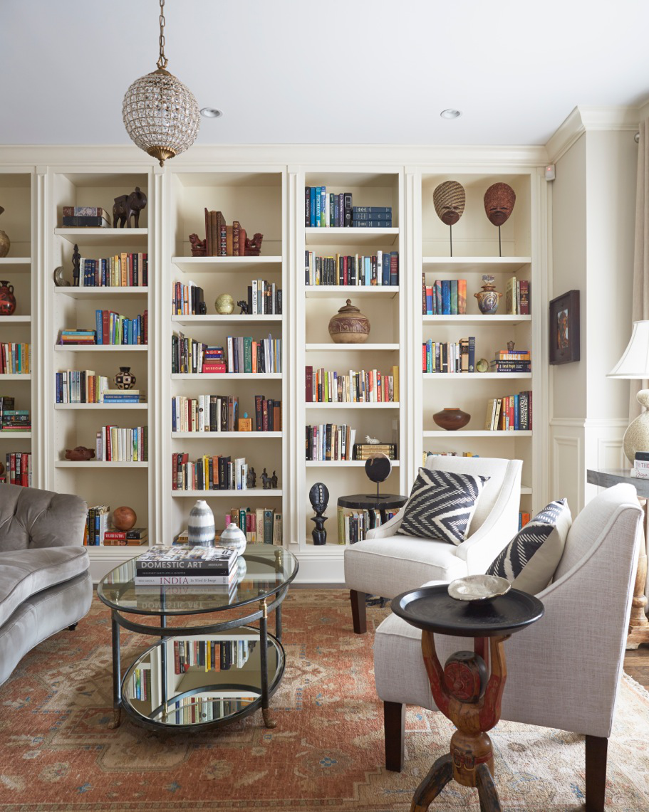 North Center living room with built-in bookcases and traditional rug by 2to5 Design