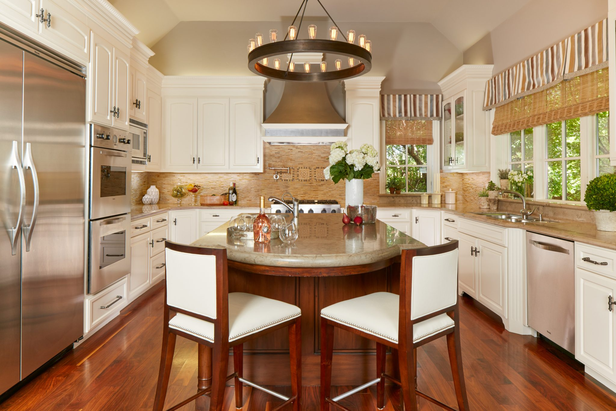 Kitchen combines white cabinets, light grey walls, cherry island and ledgestone by Alison Whittaker Design