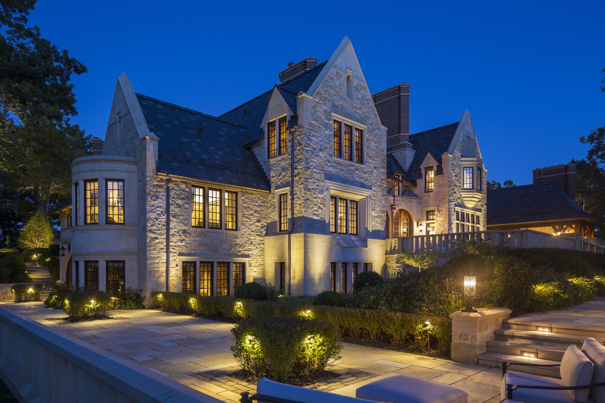 English Manor With Hand Carved Stone and Slate Roof by Murphy & Co. Design