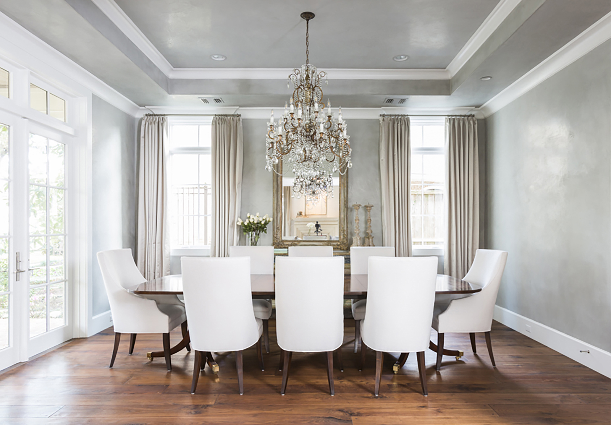 Stunning plastered dining room with antique accents by Talbot Cooley
