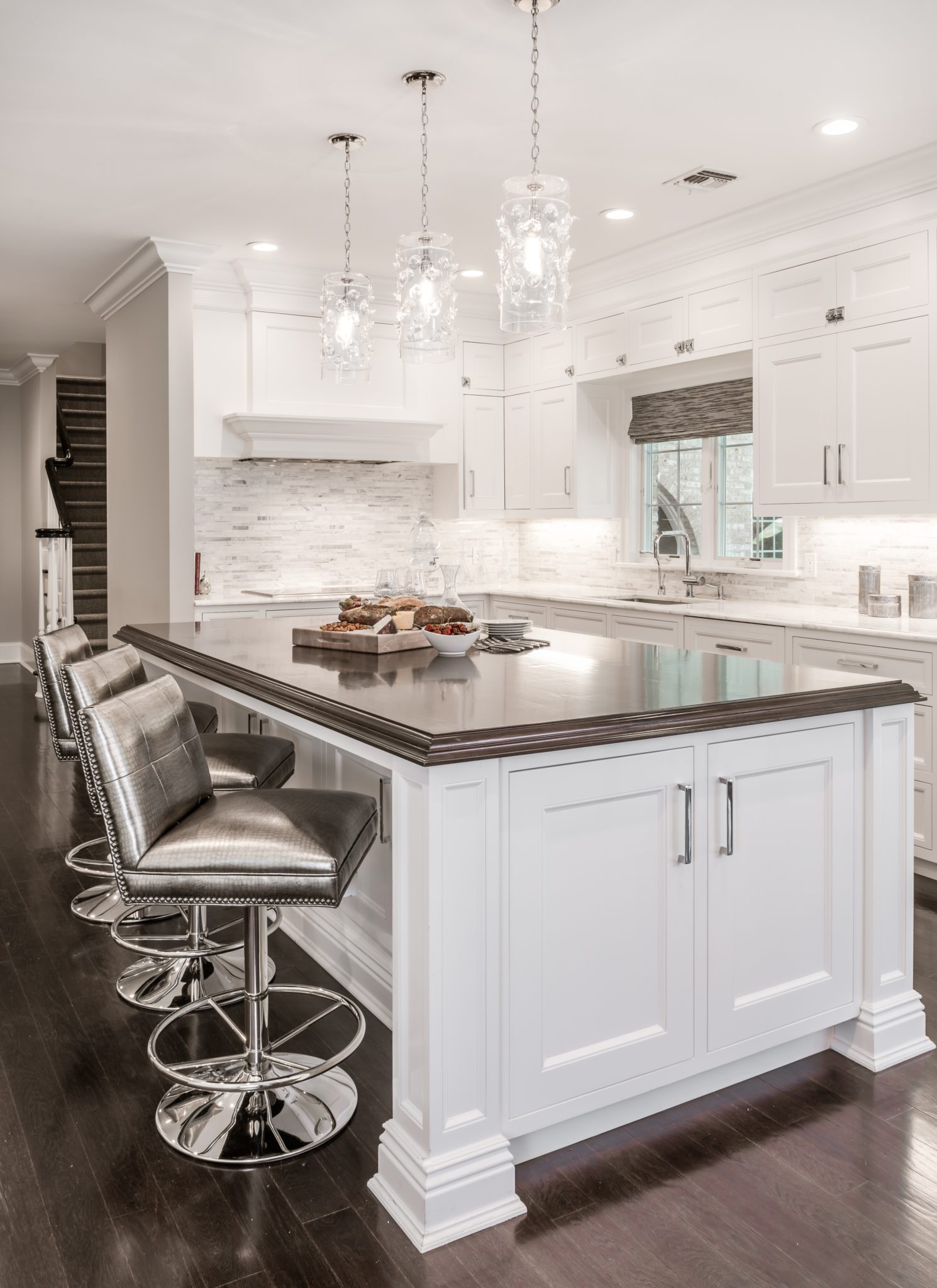 Beautiful island details and lighting in this open concept kitchen. By Kim Radovich Interiors