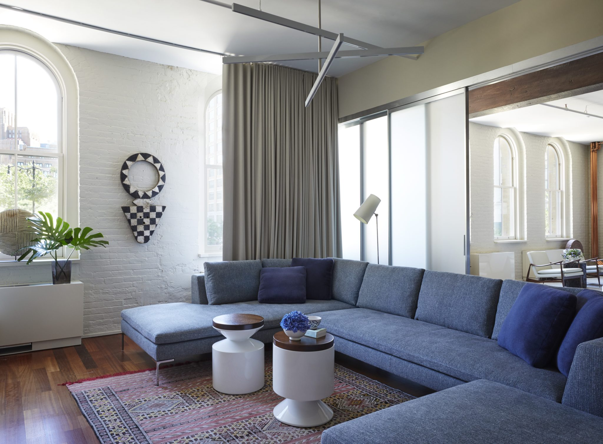 Tribeca Loft, Family Room with Sectional by Amy Kartheiser Design