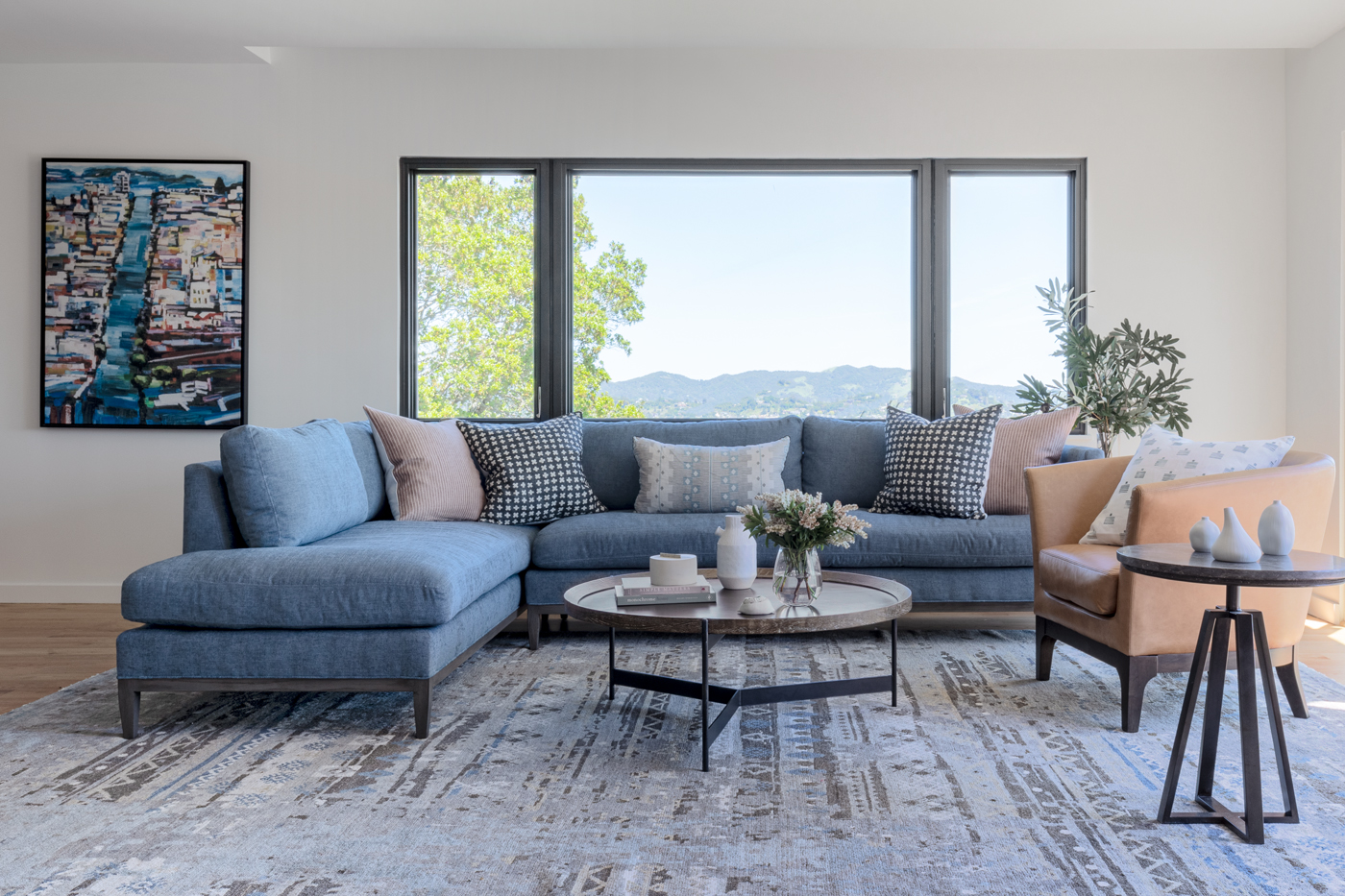 Modern Living Room with Soft Blue Sectional and a View by Florence Livingston Interiors