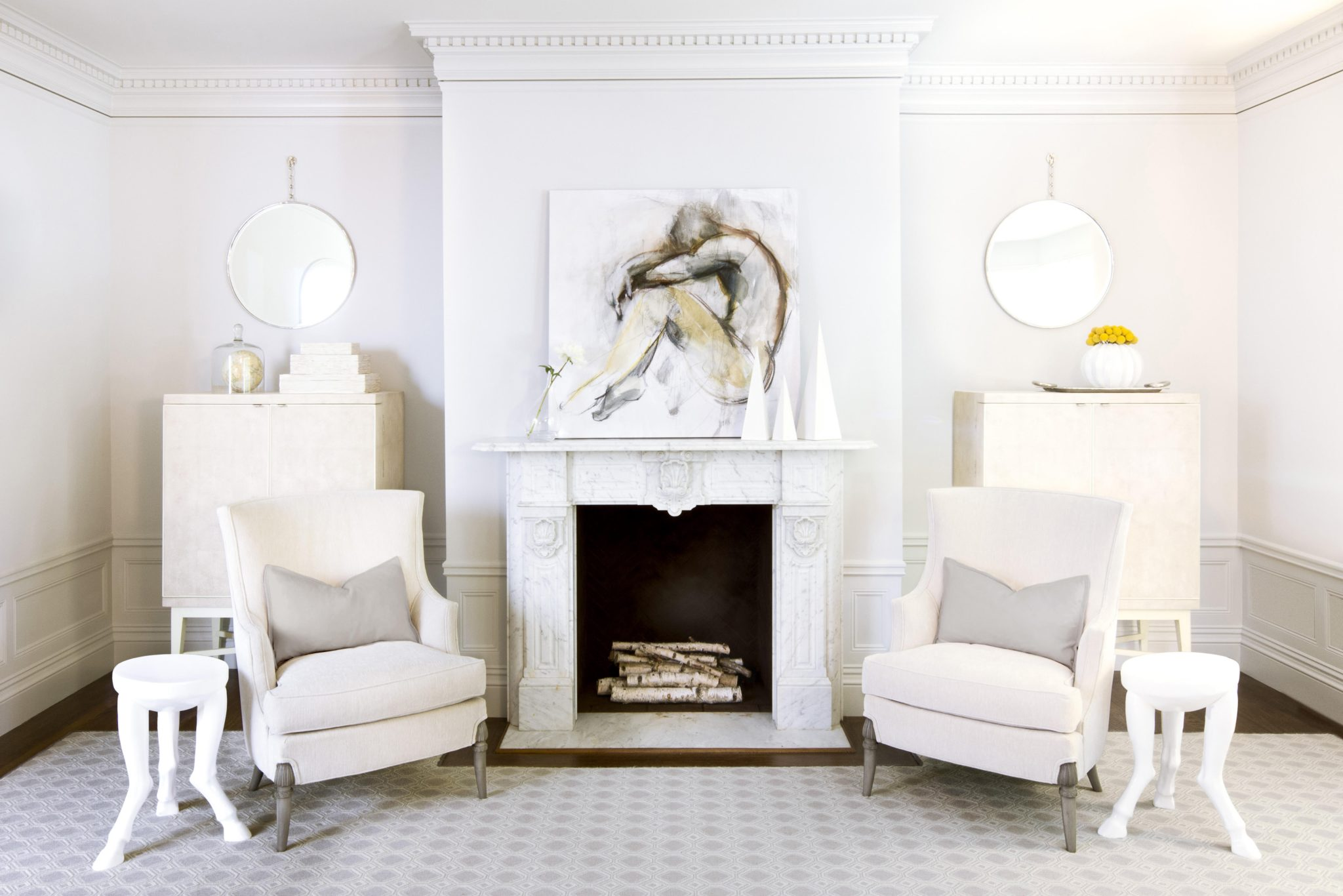 Fireplace seating area with historic moulding. by MAS Design